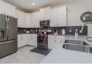 A spacious kitchen in the theme grayscale featured by a luxury vacation rental in Orlando, Florida