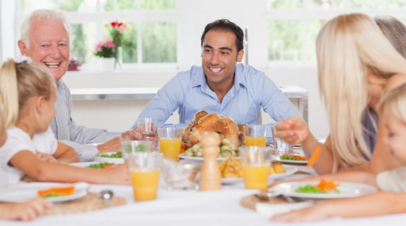Family enjoying Thanksgiving dinner together