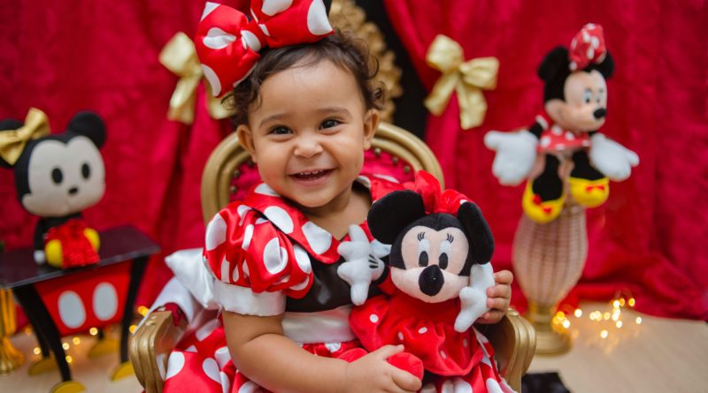 A young girl dresses up as her favorite Disney character, the iconic Minnie Mouse