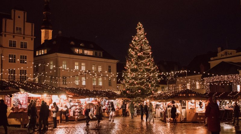 Busy marketplace with a large Christmas tree