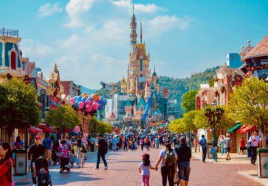 tourists visit the Disney castle at Disney World