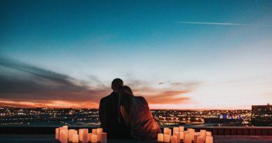 couple sitting on the sidewalk